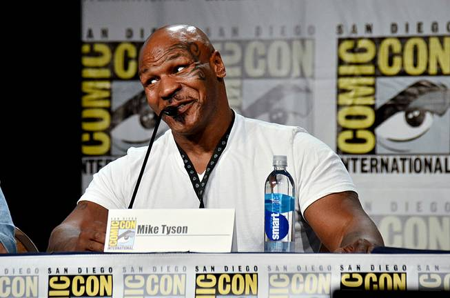 "Mike Tyson attends the ""Mike Tyson Mysteries"" panel on Day 2 of Comic-Con International on Friday, July 25, 2014, in San Diego."