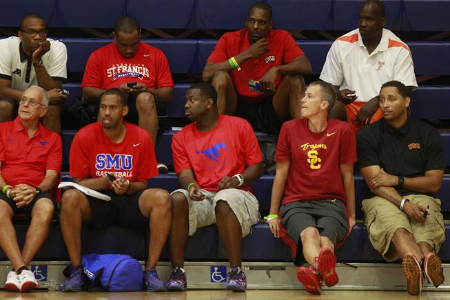 UNLV assistant coach Stacey Augmon, top row, second from right, watches the Showtime Ballers take on New Heights during their game at the Las Vegas Fab 48 tournament Friday, July 25, 2014.