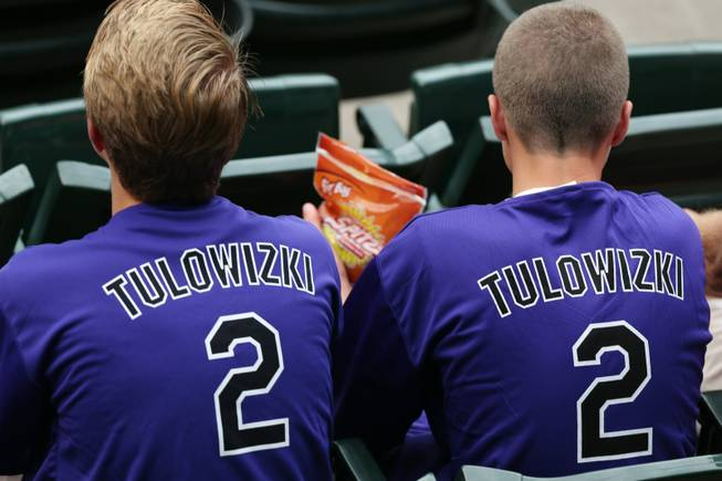 Fans wear shirts with the misspelled surname of Colorado Rockies All-Star shortstop Troy Tulowitzki that were given away to attendees as the Rockies hosted the Pittsburgh Pirates in a baseball game in Denver on Saturday, July 26, 2014.