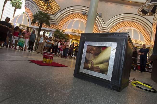 Contortionist Kelvin Gordon folds himself into a box during a performance at the Fremont Street Experience Sunday, July 27, 2014.
