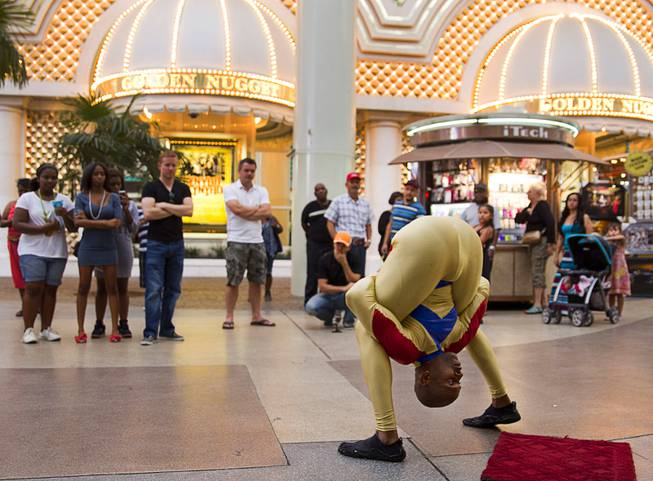 Contortionist Kelvin Gordon performs at Fremont Street Experience on Sunday, July 27, 2014, in downtown Las Vegas.