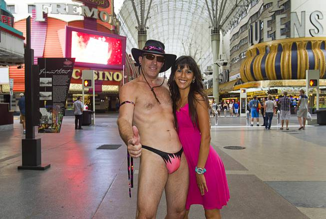 """Lucky Joe"" poses with Gina Lopez of Fresno, Calif at the Fremont Street Experience Sunday, July 27, 2014. Lucky Joe said he is retired and poses just for fun (and tips)."