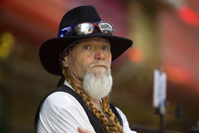Willie Nelson look-alike Clayton Knutson waits at the Fremont Street Experience Sunday, July 27, 2014.
