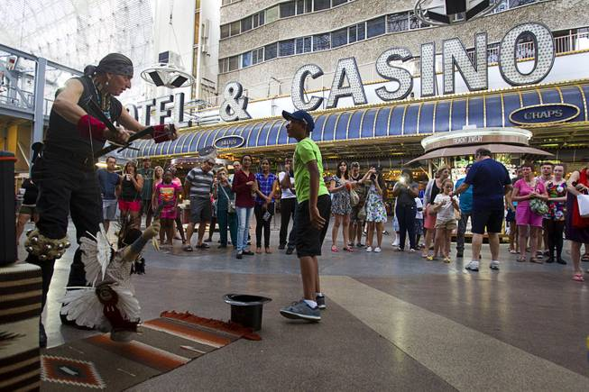 Buddy Big Mountain operates a marionette at the Fremont Street Experience Sunday, July 27, 2014.