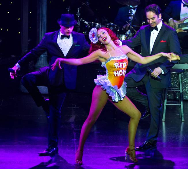 "Principal dancer Tara Palsha performs with Frank Sinatra played by Josh Strickland and Dean Martin characters during her final night in ""Vegas! The Show' on Friday, July 25, 2014."