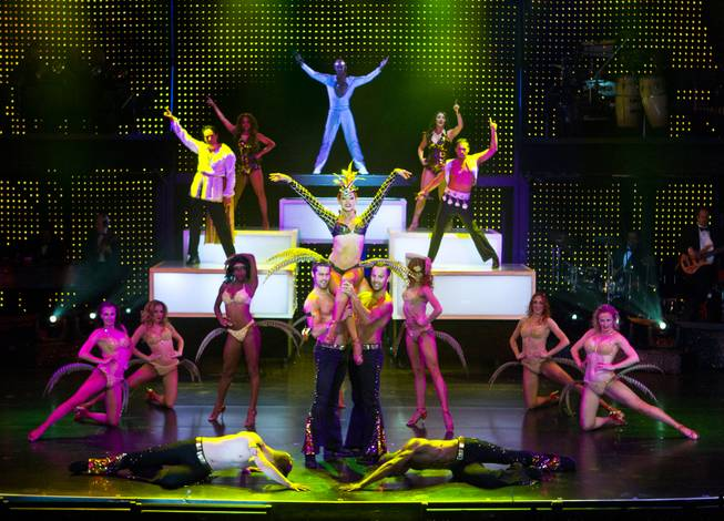 "Principal dancer Tara Palsha is hoisted by other dancers  ending a number during her final night in ""Vegas! The Show' on Friday, July 25, 2014."