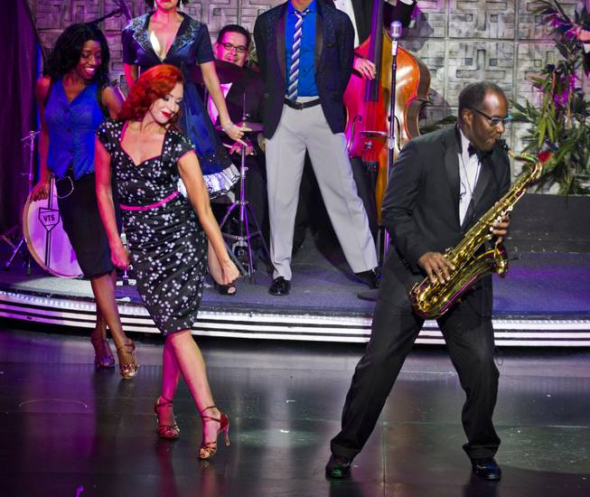"Principal dancer Tara Palsha performs with sax player Philip Wigfall and cast during her final night in ""Vegas! The Show' on Friday, July 25, 2014."