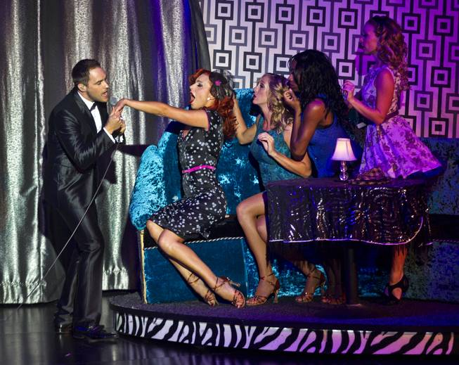 "Principal dancer Tara Palsha reacts to a pending kiss by a Wayne Newton character played by Josh Strickland while performing with the cast during her final night in ""Vegas! The Show"" on Friday, July 25, 2014, at Planet Hollywood."