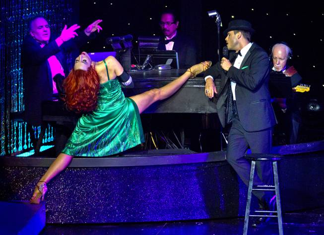"Principal dancer Tara Palsha performs with Josh Strickland performing as Frank Sinatra during her main number on her final night in ""Vegas! The Show' on Friday, July 25, 2014."