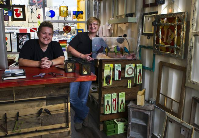 Owners Mya Daily and Ellisha Haddix of stained glass business Lead In the Window within their Container Park shop on Friday, July 25, 2014.