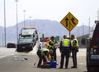 Nevada Highway Patrol troopers pack up after investigating a fatal rollover on Highway 95 southbound at Jones Boulevard Monday, July 28, 2014. A 48-year-old man was ejected from the vehicle and died at the hospital.