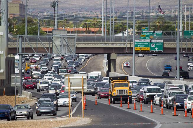 Traffic is backed up on Highway 95 southbound at Jones Boulevard after a fatal rollover Monday, July 28, 2014. A 48-year-old man was ejected from the vehicle and died at the hospital.