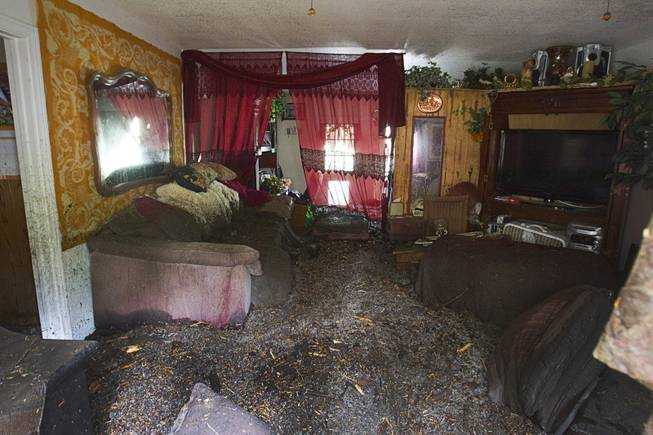 Flood damage is shown in a home in the Rainbow Subdivision on Mt. Charleston Monday, July 28, 2014. The neighborhood was hit hard by flooding and debris in runoff last year as well.
