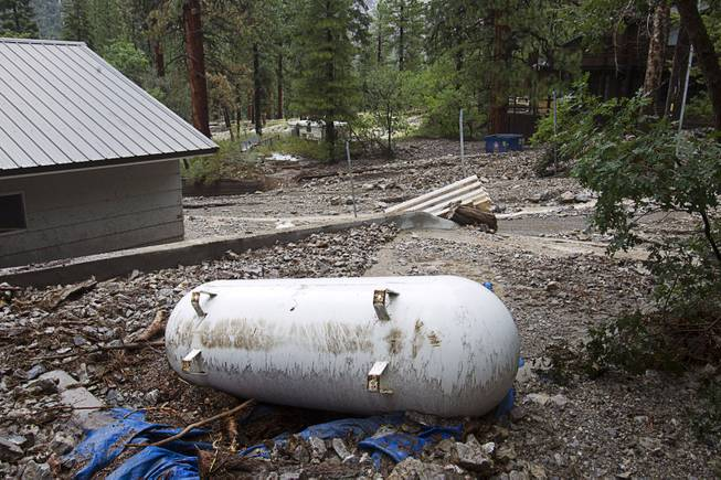 A propane tank is shown by a home in the Rainbow Subdivision on Mt. Charleston Monday, July 28, 2014. The neighborhood was hit hard by flooding and debris in runoff last year as well.