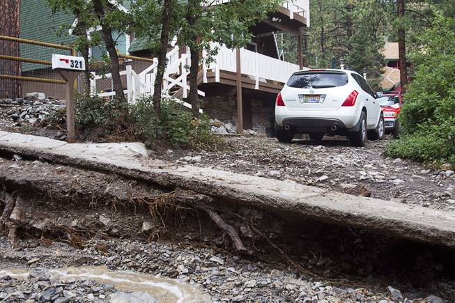 A resident is cut-off from Rainbow Canyon Boulevard in the Rainbow Subdivision on Mt. Charleston Monday, July 28, 2014. The neighborhood was hit hard by flooding and debris in runoff last year as well.