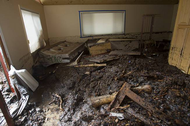 Debris is shown inside a home in the Rainbow Subdivision on Mt. Charleston Monday, July 28, 2014. The homeowners were still repairing the home from last year's storm, neighbors said.