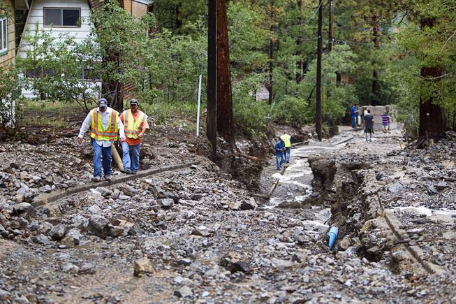 A view of damage to Rainbow Canyon Boulevard in the Rainbow Subdivision on Mt. Charleston Monday, July 28, 2014. The neighborhood was hit hard by flooding and debris in runoff last year as well.