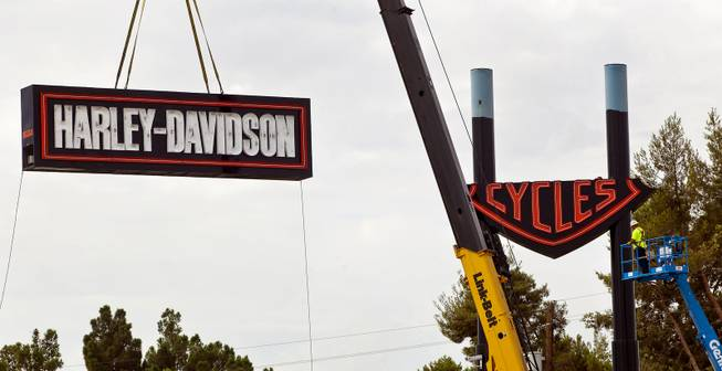 Workers with the Ad Art Sign Company mount the three-piece sign outside the new Las Vegas Harley-Davidson Motorcycle dealership on the South Strip now under construction Thursday, July 10, 2014.