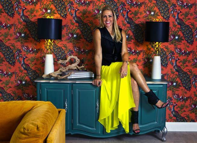 "Melissa Roche sits on her cabinet in Parlor 430 on Monday, July 28, 2014. She is a local interior designer and Season 2 winner on HGTVs ""Brother vs. Brother."""