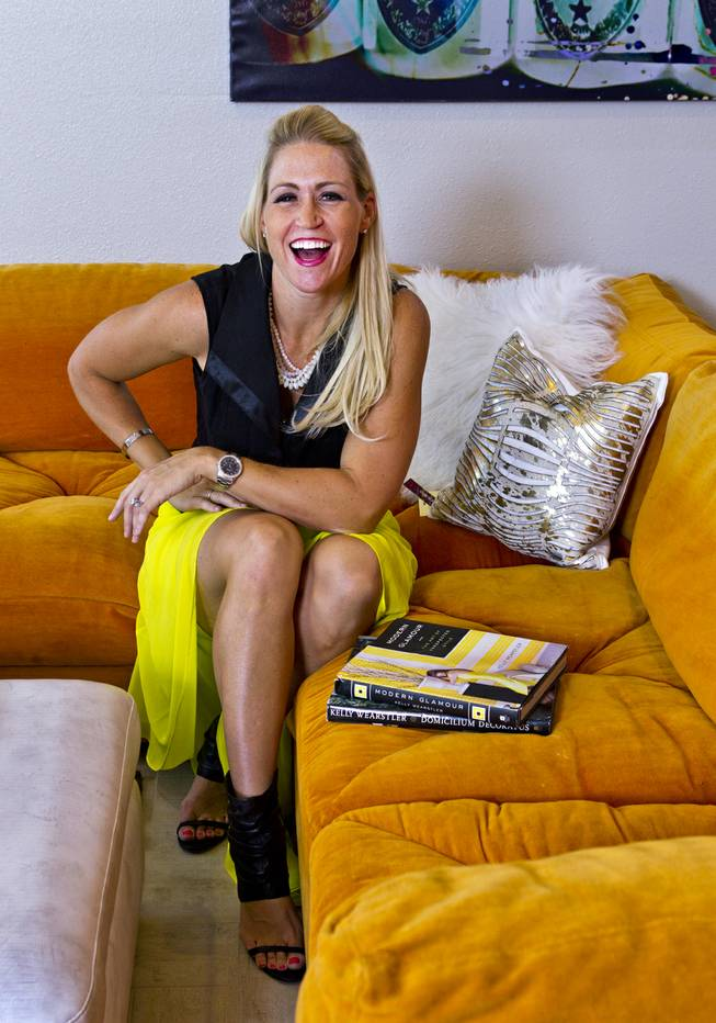 "Melissa Roche laughs on her couch in Parlor 430 on Monday, July 28, 2014. She is a local interior designer and Season 2 winner on HGTVs ""Brother vs. Brother."""