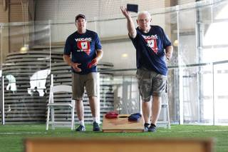Tim Malte, left, and Keith Goodman compete during a cornhole tournament Saturday, July 26, 2014.