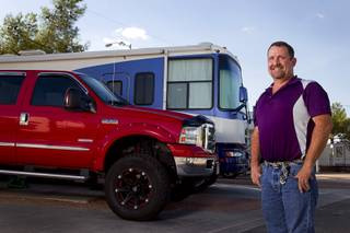 Cass Via, a maintenance worker at the High Roller, poses outside his RV at the Oasis Las Vegas RV Resort Tuesday, July 29, 2014. Via is in the market for a house but says he will be buying a pre-owned home, not a new home.