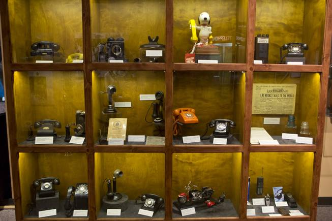 "A visual timeline of telephones are on display at the ""Every Age is an Information Age"" exhibit at the Nevada State Museum, Friday July 25, 2014. The exhibit shows 150 years of communication technology in Nevada."