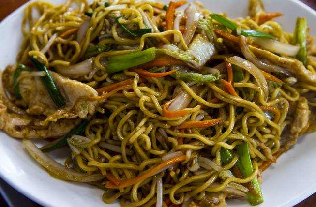 Chicken Chow Mein dish by Chef Ivo Karkaliev now cooking Chinese food for the Cafe Fiesta at Fiesta Henderson on Monday, July 28, 2014.