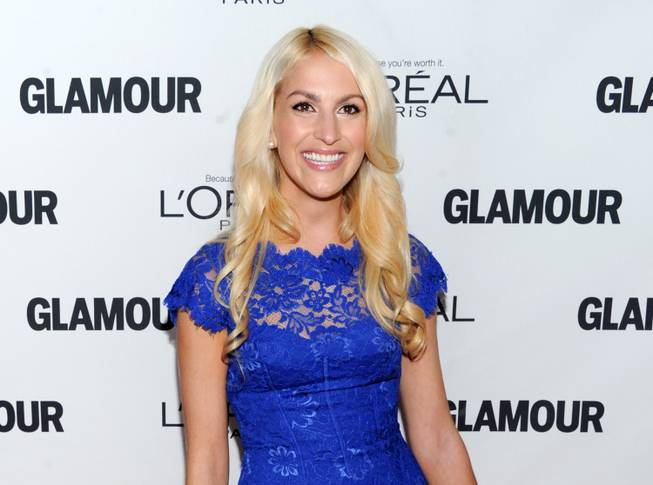 "This Nov. 11, 2013,  file photo shows honoree Kaitlin Roig-DeBellis attending the 23rd Annual Glamour Women of the Year Awards at Carnegie Hall in New York. Roig-DeBellis, a teacher at Sandy Hook Elementary School who helped save students' lives during a mass shooting, has a book deal. G.P. Putnam's Sons for ""Choosing Hope: Moving Forward from Your Life's Darkest Hour."" The book will be released in the spring of 2015."