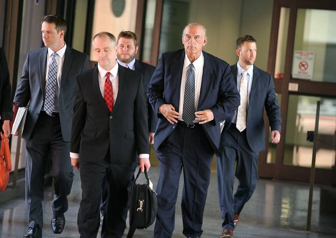 Former Minnesota Gov. Jesse Ventura, second from right, makes his way out of the Warren E. Burger Federal Building during the first day of jury selection in a defamation lawsuit Tuesday, July 8, 2014, in St. Paul, Minn. Ventura filed the defamation lawsuit against the Chris Kyle estate claiming that Kyle's account of a bar fight in a book he wrote was false.