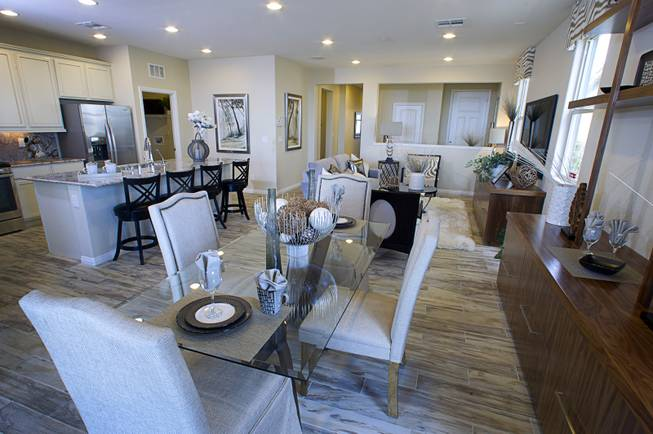 The great room (kitchen, living, dining) in a one-story plan 1849 model home at KB Homes' Tevare residential development in Summerlin Wednesday, July 30, 2014.