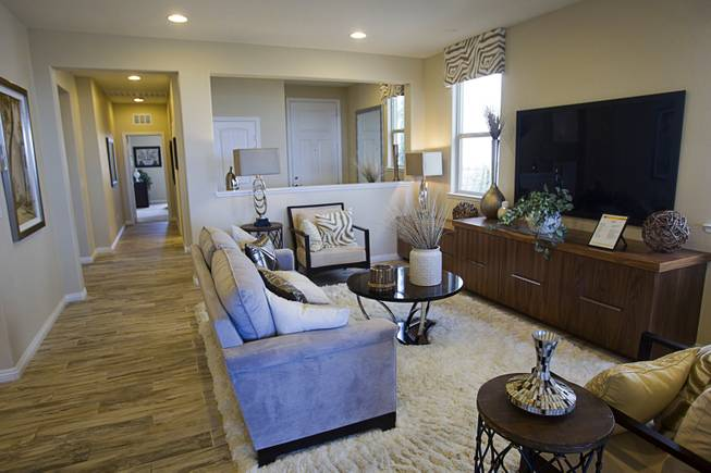 The living area is shown in a one-story plan 1849 model home at KB Homes' Tevare residential development in Summerlin Wednesday, July 30, 2014.