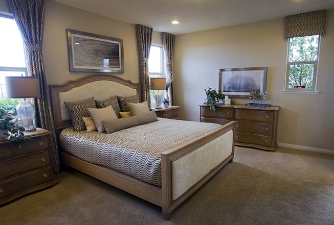 The master bedroom is shown in a one-story plan 1849 model home at KB Homes' Tevare residential development in Summerlin Wednesday, July 30, 2014.