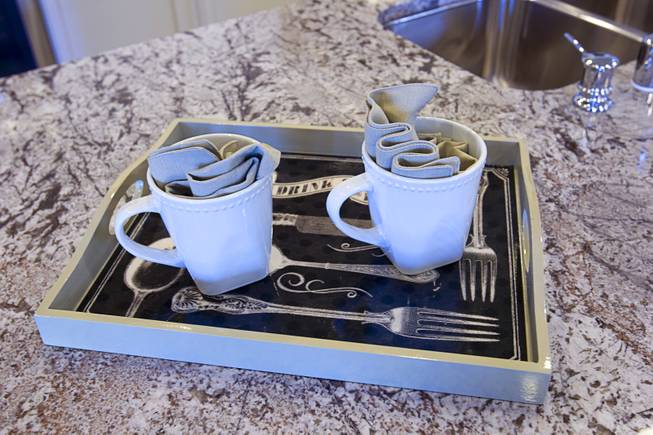 Two coffee cups are shown in the kitchen of a one-story plan 1849 model home at KB Homes' Tevare residential development in Summerlin Wednesday, July 30, 2014.