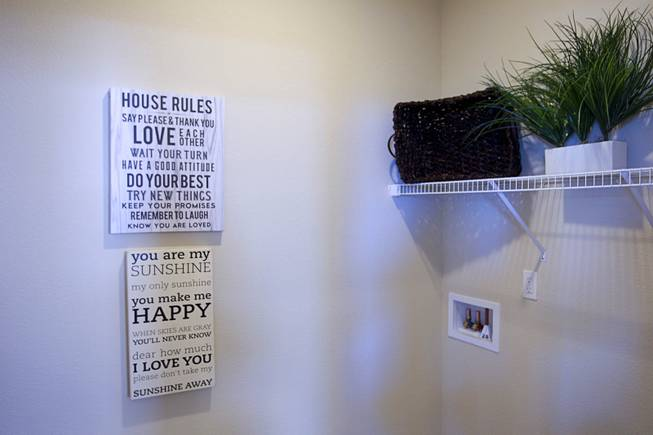 Signs are displayed in the laundry area of a one-story plan 1849 model home at KB Homes' Tevare residential development in Summerlin Wednesday, July 30, 2014.  Signs are displayed in a laundry area of