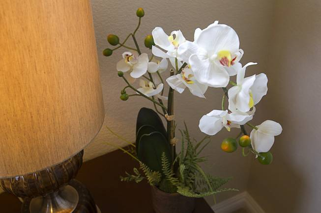 An orchid decorates a guest bedroom in a one-story plan 1849 model home at KB Homes' Tevare residential development in Summerlin Wednesday, July 30, 2014.