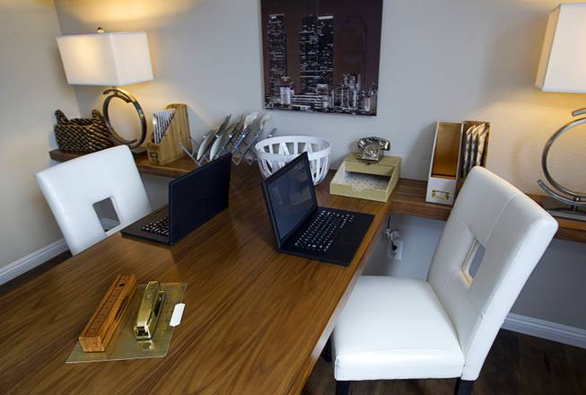 A shared work area is shown in a one-story plan 1849 model home at KB Homes' Tevare residential development in Summerlin Wednesday, July 30, 2014.
