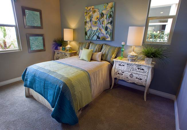 A downstairs guest bedroom is shown in a two-story plan 2568 model home at KB Homes' Tevare residential development in Summerlin Wednesday, July 30, 2014.