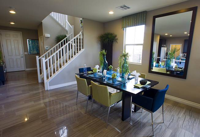 A dining area is shown in a two-story plan 2568 model home at KB Homes' Tevare residential development in Summerlin Wednesday, July 30, 2014.