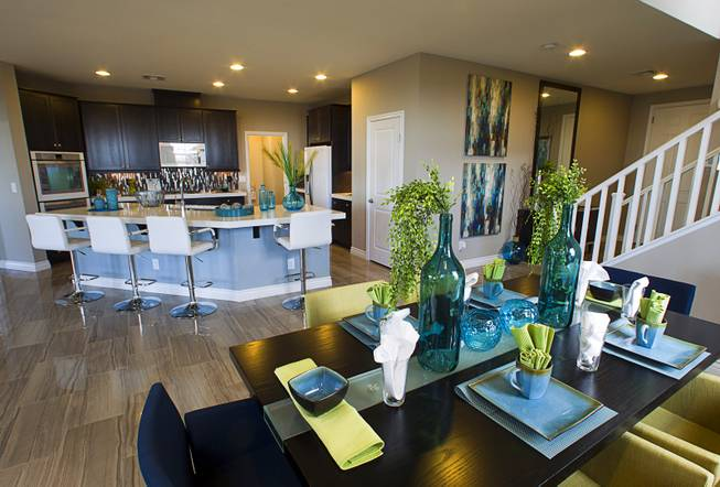 A dining area and kitchen are shown in a two-story plan 2568 model home at KB Homes' Tevare residential development in Summerlin Wednesday, July 30, 2014.