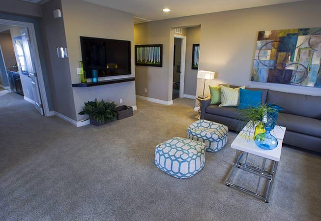 An upstairs family room is shown in a two-story plan 2568 model home at KB Homes' Tevare residential development in Summerlin Wednesday, July 30, 2014.