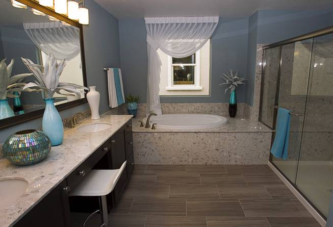 The master bathroom is shown in a two-story plan 2568 model home at KB Homes' Tevare residential development in Summerlin Wednesday, July 30, 2014.