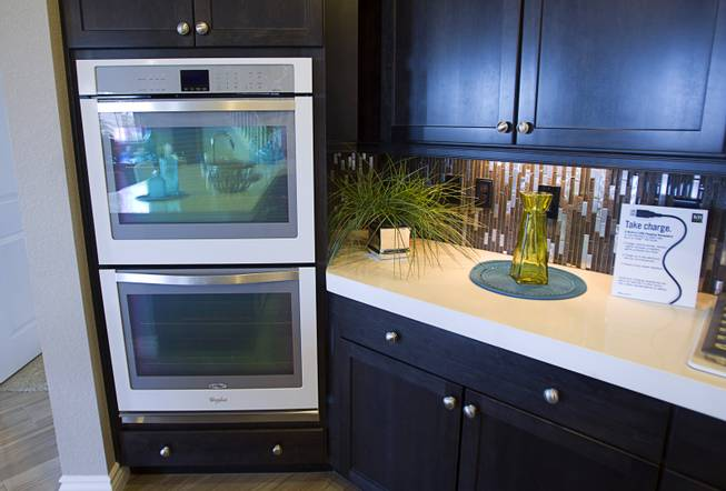 Double ovens are shown in the kitchen of a two-story plan 2568 model home at KB Homes' Tevare residential development in Summerlin Wednesday, July 30, 2014.