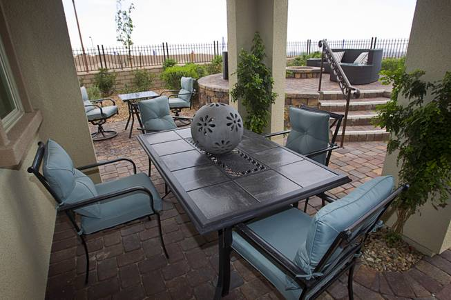 A large patio area is shown in the backyard of a two-story plan 2568 model home at KB Homes' Tevare residential development in Summerlin Wednesday, July 30, 2014.