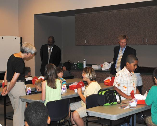 Assistant Secretary of Agriculture for Administration Dr. Greg Parham and StrikeForce National Coordinator Max Finberg mingle with students during the USDA's visit to Cambridge Recreation Center for Three Square Food Bank's Summer Food Service Program.