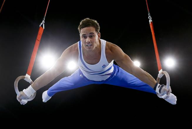 Silver medalist Daniel Keatings of Scotland performs on the rings during the Men's All-Around gymnastics competition at the Scottish Exhibition Conference Centre during the Commonwealth Games 2014 in Glasgow, Scotland, Wednesday July 30, 2014.