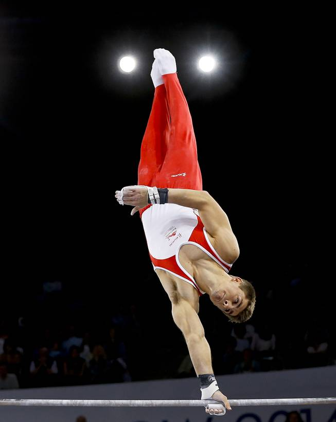 Gold medal winner Max Whitlock of England performs on the horizontal bar during the Men's All-Around gymnastics competition at the Scottish Exhibition Conference Centre during the Commonwealth Games 2014 in Glasgow, Scotland, Wednesday July 30, 2014.