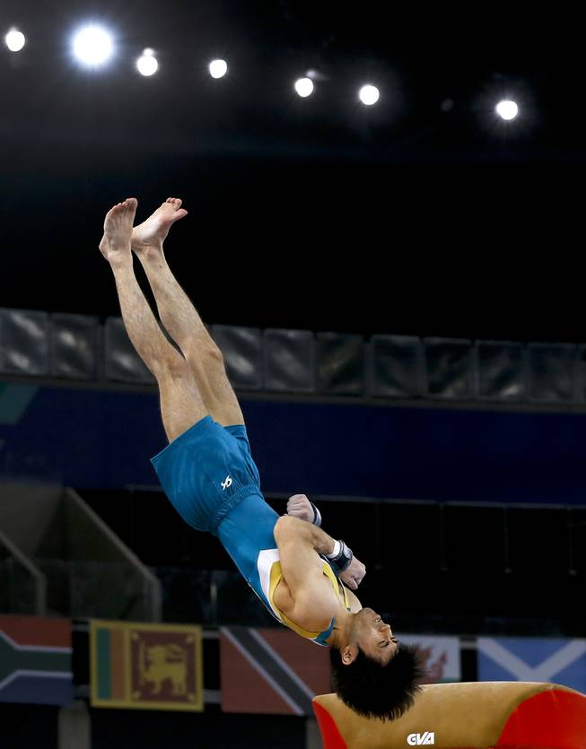Naoya Tsukahara of Australia performs on the vault during the Men's All-Around gymnastics competition at the Scottish Exhibition Conference Centre during the Commonwealth Games 2014 in Glasgow, Scotland, Wednesday July 30, 2014.