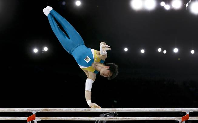 Naoya Tsukahara of Australia performs on the parallel bars during the Men's All-Around gymnastics competition at the Scottish Exhibition Conference Centre during the Commonwealth Games 2014 in Glasgow, Scotland, Wednesday July 30, 2014.