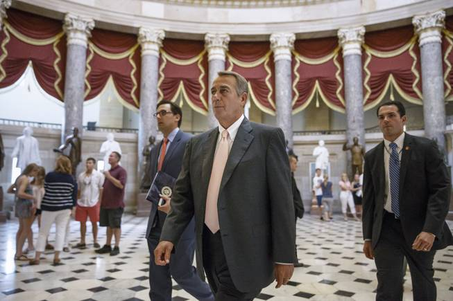 House Speaker John Boehner of Ohio strides to the House chamber on Capitol Hill in Washington, Wednesday, July 30, 2014, as lawmakers prepared to move on legislation authorizing an election-year lawsuit against President Barack Obama that accuses him of exceeding his powers in enforcing his health care law.